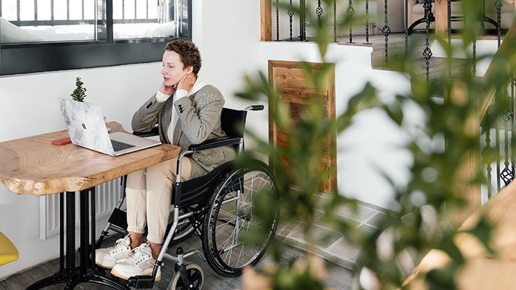 disabled woman in wheelchair at home