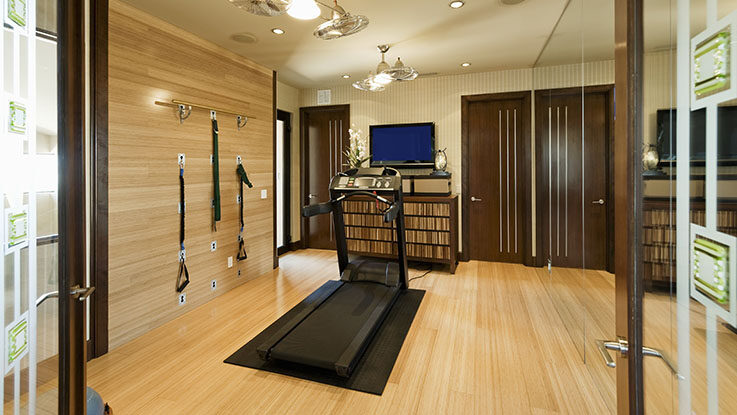 home interior with gym equipment and wooden floor