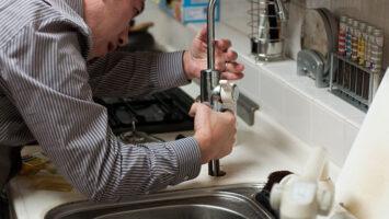 plumber repairing working