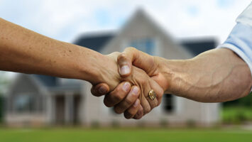 shake hands in front of house
