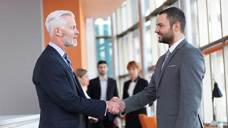 2 business men handshake